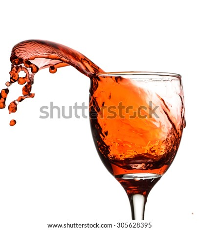 wine splash in the glass - stock photo