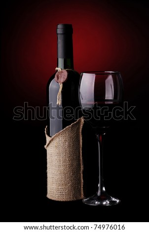 Wine Still Life with a dark red background - stock photo