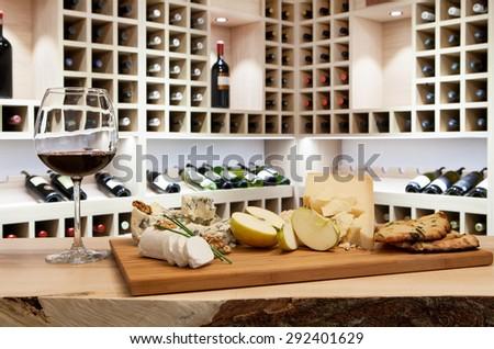 Wine tasting in wine rack - stock photo