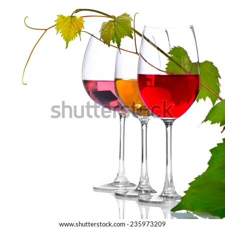 Wine. Three Glasses of wine isolated on white background. Glass of rose, red and white wine decorated with grape leaves. Vine leaf - stock photo