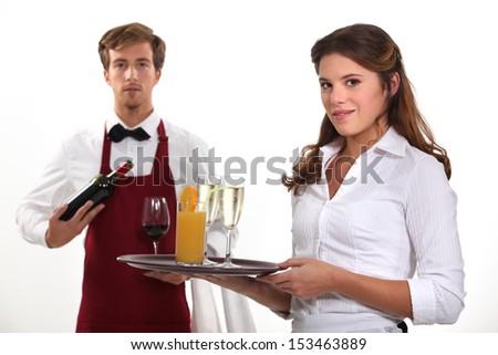 Wine waiter and waitress, studio shot - stock photo