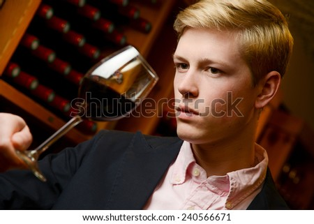 Wine Waiter tasting wine in a cellar