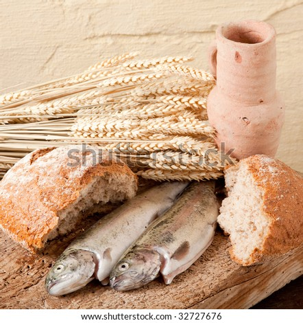 Wine, wheat, bread and fish as symbols of religion - stock photo