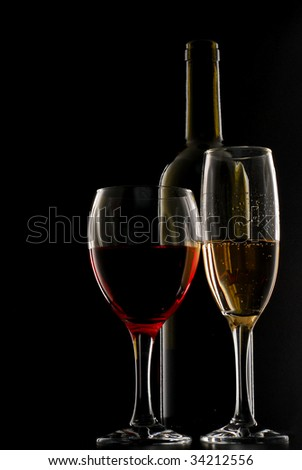Wine with bottle beside and an abstract low-light background