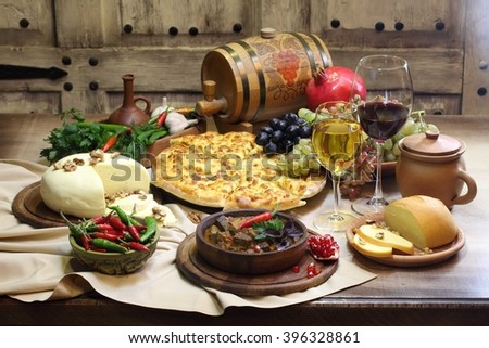 wine with cheese and fruit and meat with hot pepper