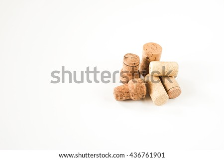 Wine wooden cork on white background. From alcohol beverage. Vintage brown winery object. Natural texture. Wood stopper collection. - stock photo