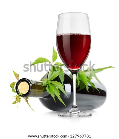 Wineglass and wine bottle with vine isolated on white background