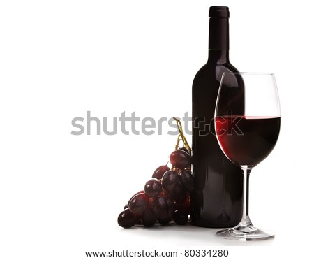 Wineglass of red wine and bottle with grape, isolated on white background. - stock photo