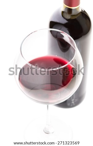 Wineglass with red wine and bottle isolated on white background. Close up image of wineglass - stock photo