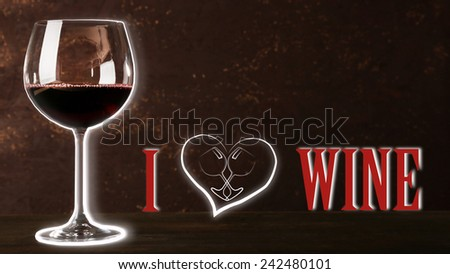 Wineglass with red wine and I love wine text, on dark brown background - stock photo