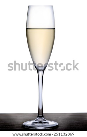 Wineglass with white wine on a wooden tray - stock photo