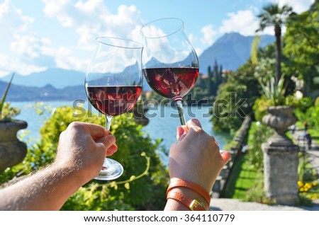 Wineglasses against lake Como, Italy