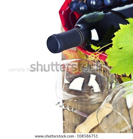 Wineglasses and bottle of red wine in basket over white (with easy removable sample text) - stock photo