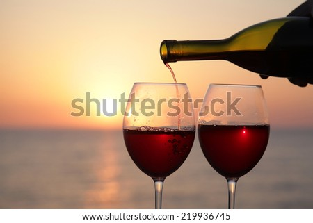wineglasses of wine at sunset