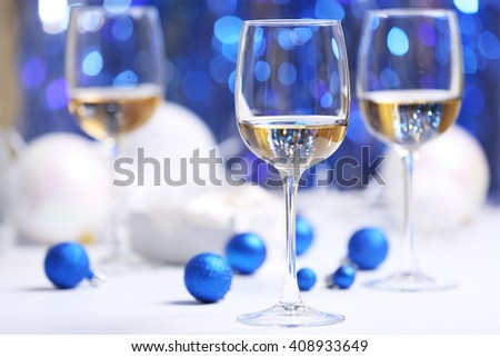 Wineglasses on blue blurred background - stock photo