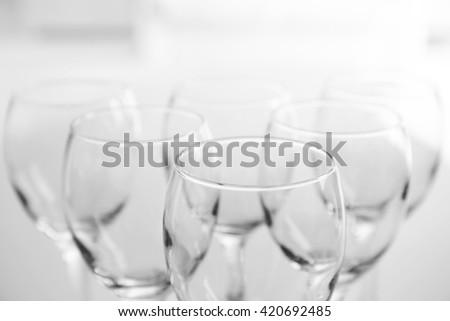 Wineglasses on blurred interior background - stock photo