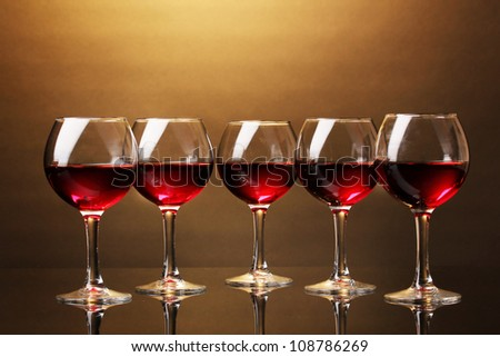 Wineglasses on brown background