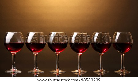 Wineglasses on brown background - stock photo