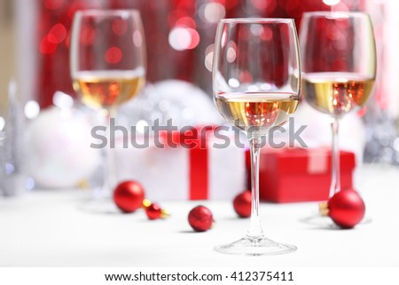 Wineglasses on red blurred lights background - stock photo