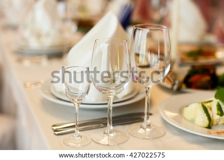 Wineglasses served for a festive dinner - stock photo