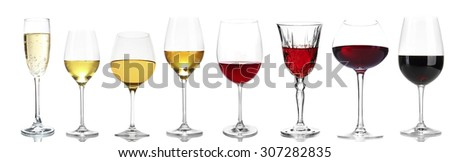 Wineglasses with different wine, isolated on white - stock photo