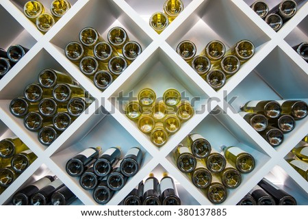 Wines White Wooden Shelve in Wines Cellar. Wines Selection. - stock photo