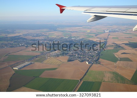 Wing aircraft and a beautiful view of the earth from an airplane window - stock photo