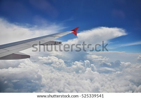 wing aircraft hovering above the clouds