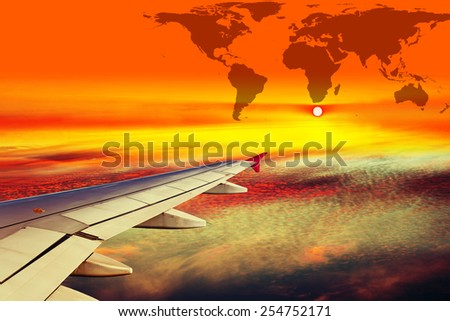 Wing airplane on World map background. - stock photo