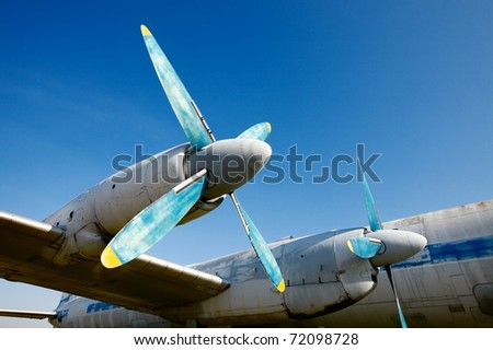 Wing and engines of an old airplane - stock photo