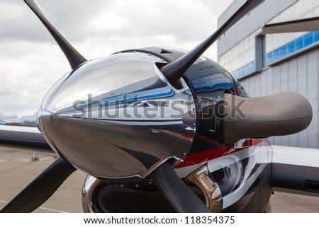 Wing and piston engine and blades airliner photo - stock photo