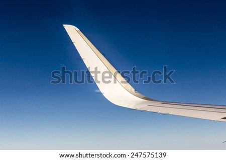 wing and wingtip device under clear blue sky - stock photo