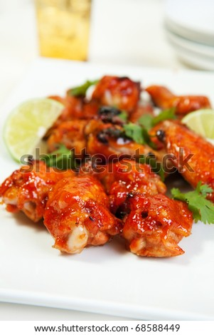 Wing dings glazed with a spicy asian sauce - stock photo