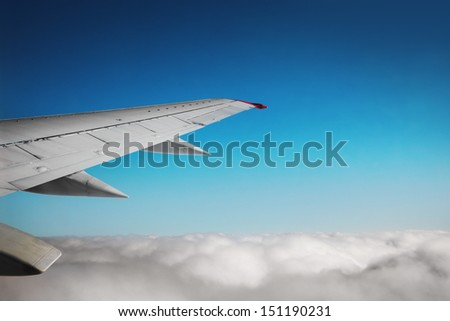 Wing of an airplane - stock photo
