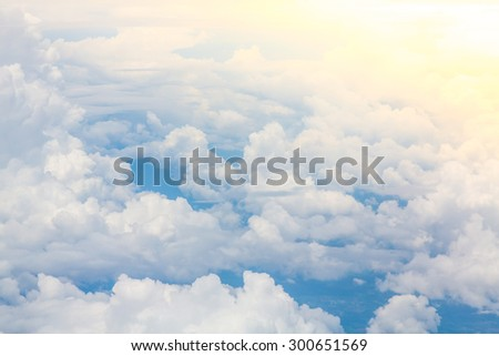 Wing of an airplane flying above the clouds - stock photo