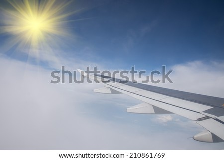 Wing of an airplane flying in the sky so beautiful.