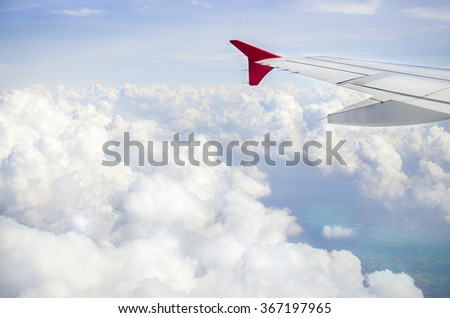 Wing of an airplane in cloudy, View of jet plane wing , With place for your text