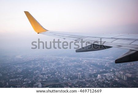Wing of an airplane on blue sky