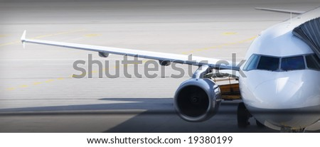 Wing of the plane, cockpit and front cabin - stock photo