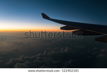 wing plane and the view from the height of the window jet aircraft. twilight sky
