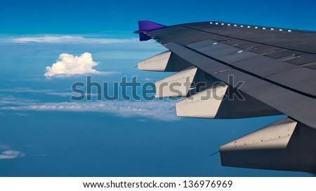 Wing with a beautiful sky - stock photo