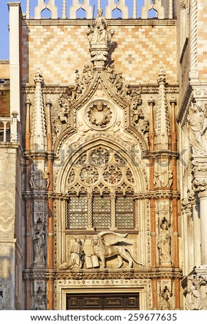 Winged lion and the Doge's Palace, the famous symbols of Venice.  Venice is UNESCO World Heritage Site, Italy - stock photo
