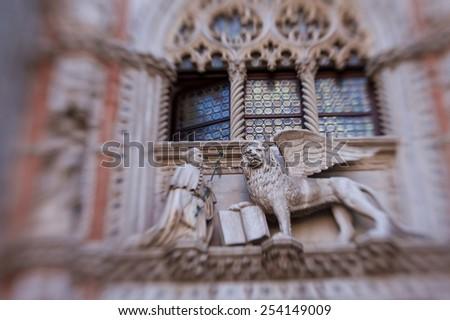 winged lion decoration on Doge's Palace  - stock photo