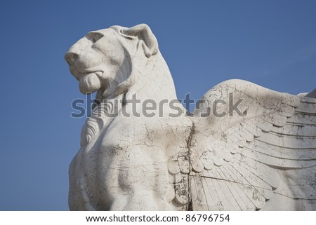 Winged lion seen against the blue sky - a detail of the Victor Emmanuel monument at Piazza Venezia -  Rome, Italy. Build as a tribute to the first king of united Italy - Victor Emmanuel II. - stock photo