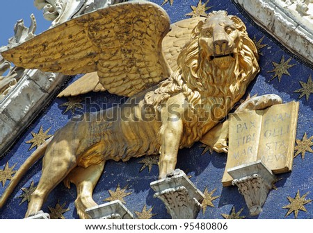 Winged Lion -  symbol of St Mark - with  book quoting :Pax Tibi Marce Evangelista Meus ( Peace to you Mark, my evangelist )  detail  from the facade of  San Marco Basilica in Venice, Italy, Europe - stock photo