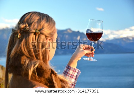 Winglass in the hand. Lavaux. Switzerland - stock photo