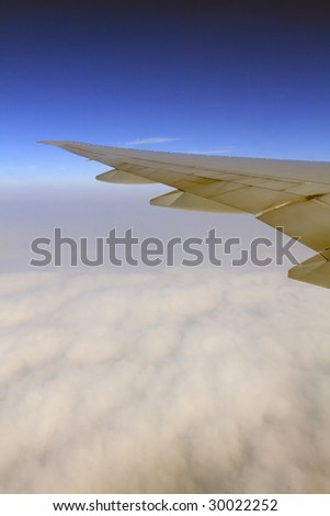 wings in the blue sky - stock photo