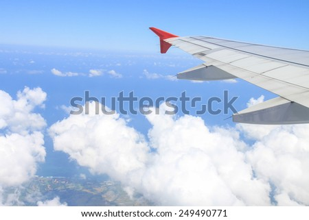 Wings of an airplane flying