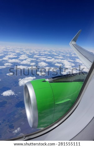 Wings of an airplane flying - stock photo