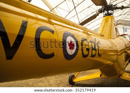 WINGS & WHEELS CALGARY CANADA 21 6 2015:Father's Day Weekend where some vintage Cars and Air crafts on display. A vintage helicopter tail section on display. - stock photo